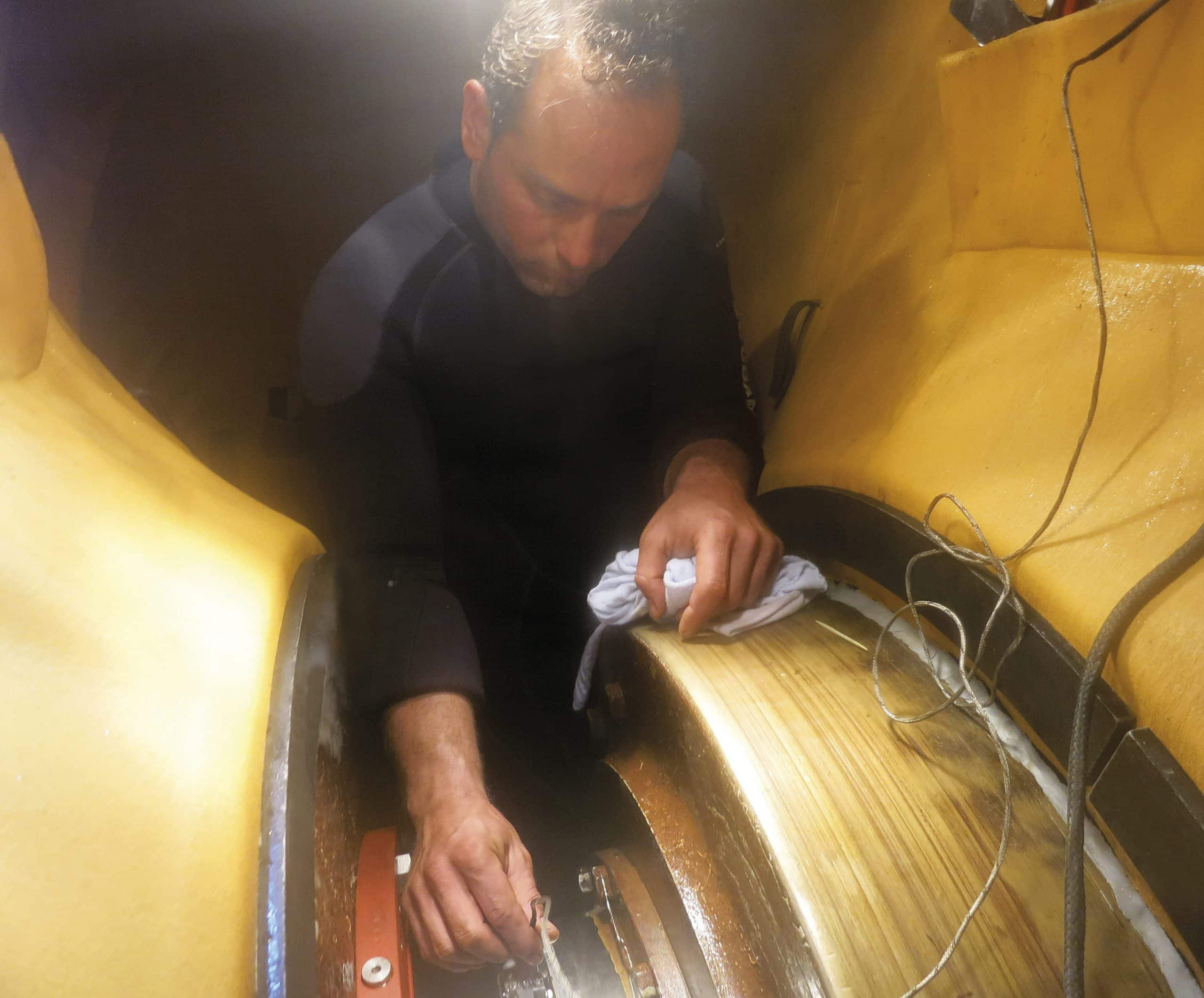 Hydrex diver working on the assembly inside the flexible mobdock.