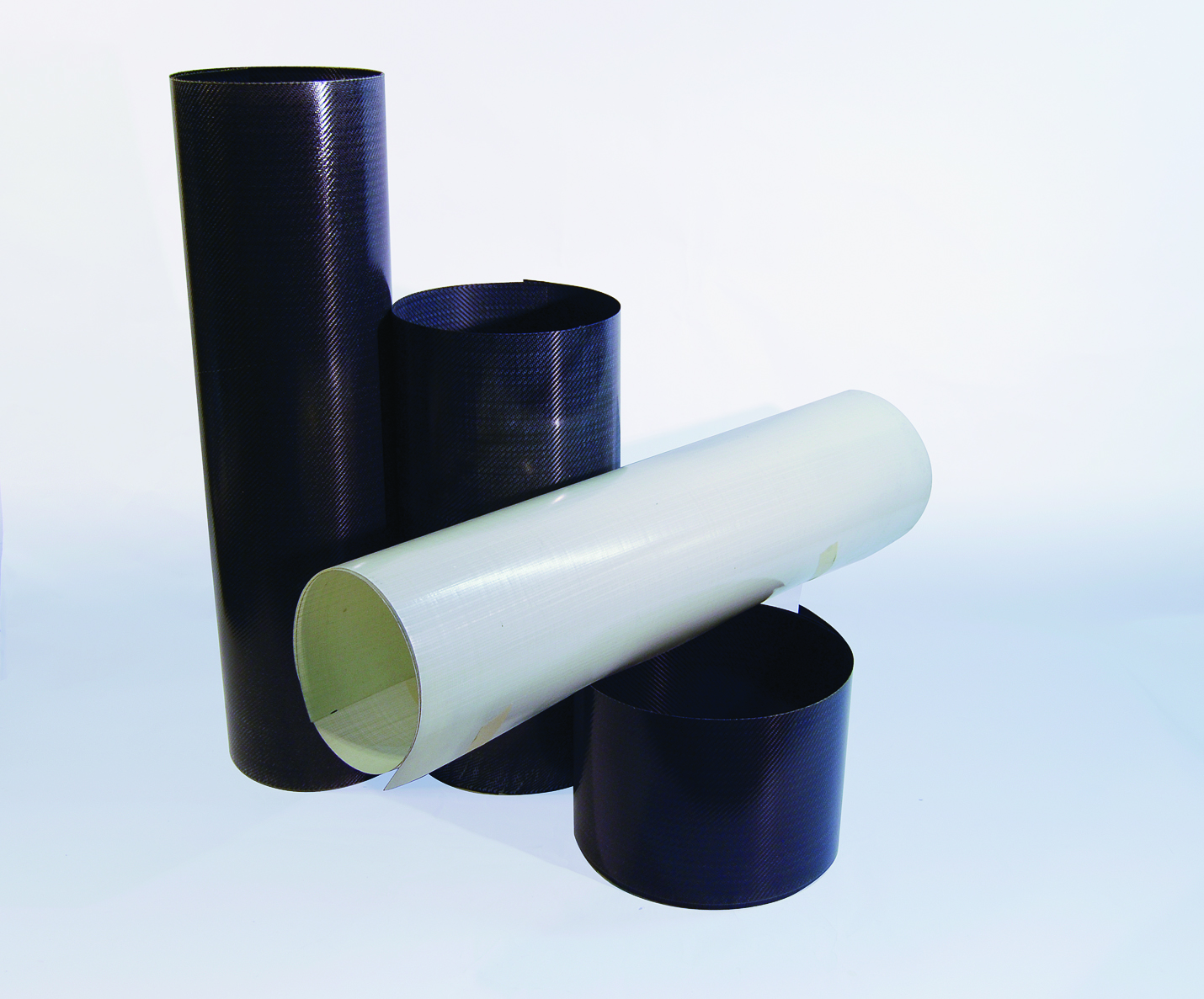 Fig. 2: Sample rolls of PileMedicTM carbon and glass laminates Comparison of Tensile Strength with