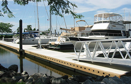 The Unifloat concrete floating dock system from Bellingham Marine utilizes a waler system to connect individual float modules together.